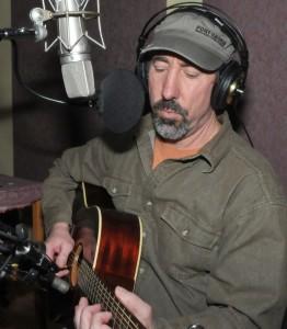 Robert Stevens playing guitar